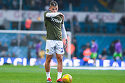 Kalvin Phillips of Leeds United (23) wipes his mouth whilst warming up during the EFL Sky Bet Championship match between Leeds United and Bristol City at Elland Road, Leeds, England on 24 November 2018.