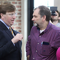 Lieutenant Governor Tate Reeves talks with Ed Holliday, of Tupelo, during a campaign stop for his run for Govenor on Tuesday morning at Papa V's in Tupelo.