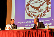 Old Westbury, New York, U.S. 8th October 2013. At table, R-L, Republican EDWARD MANGANO, the Nassau County Executive, and Democrat THOMAS SUOZZI, the former County Executive, face each other in a debate hosted by the Nassau County Village Officials Association, representing 64 incorporated villages with 450,000 residents, as the opponents face a rematch in the 2013 November elections.