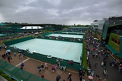 LONDON, ENGLAND - Monday, July 2, 2012: Rain stops play on the outside courts during day seven of the Wimbledon Lawn Tennis Championships at the All England Lawn Tennis and Croquet Club. (Pic by David Rawcliffe/Propaganda)