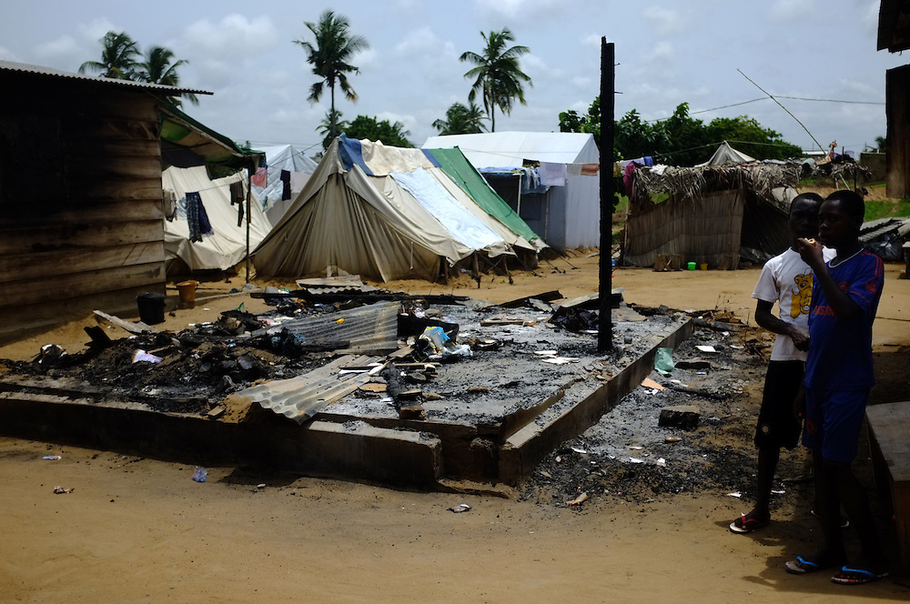 AVEPOZO, TOGO  13-05-04   - Boys stand near a hut destroyed during violent clashes between refugees and Togolese Gendarmes at the Avepozo Refugee Camp. Photo by Daniel Hayduk