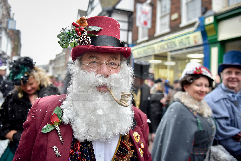 © Licensed to London News Pictures. 03/12/2017. Rochester, UK.  Participants take part in the annual Dickensian Christmas Festival in Rochester.  The Kent town is given a Victorian makeover to celebrate the life of the writer Charles Dickens (who spent much of his life there), with Victorian themed street entertainment, costumed parades and a Christmas market.  Photo credit: Stephen Chung/LNP