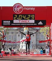 The winner of the Elite Men's race Wilson Kipsang of Kenya crosses the finishing line on The Mall in a winning time of 02:04:29 at The Virgin Money London Marathon 2014 on Sunday 13 April 2014<br /> Photo: Roger Allan/Virgin Money London Marathon<br /> media@london-marathon.co.uk
