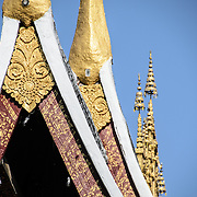 Roof of Wat Xieng Thong (Temple of the Golden City) on the northern tip of the peninsula of Luang Prabang, Laos. Originally built around 1560, the temple was the main site for royal coronations and remains ones of the most important temples in Laos.