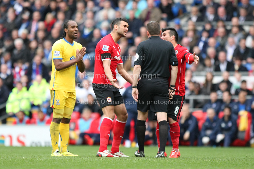 Steven Caulker and Gary Medel of Cardiff City appeal a decision with the referee Phil Dowd. Barclays Premier league match, Cardiff city v Crystal Palace at the Cardiff city stadium in Cardiff, South Wales on Saturday 5th April 2014.<br /> pic by Mark Hawkins, Andrew Orchard sports photography.