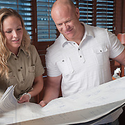 Advertising photography for Lynn Donaldson &amp; Associates. <br /> Interior designer and contractor reading plans.