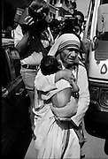 Beirut, Lebanon June 14th 1982. Sabra palestinian refugees camp. Sabra psychiatric hospital . Mother Theresa, the famous nun from Calcutta,  holds a sick and starving child in her harms during the evacuation of  the frequently targetted Hospital since the beggining of the Israeli offensive. ©Herve Merliac