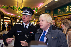 Ealing, London, December 9th 2014. Mayor of London Boris Johnson visits Ealing accompanied by Met Police Commissioner Sir Bernard Hogan-Howe hold a walkabout in Ealing to announce details of the historic deal secured for the New Scotland Yard site in Victoria. PICTURED: The Met Police Commissioner Sir Bernard Hogan-Howe and Mayor of London walk through Ealing Broadway Shopping Centre.