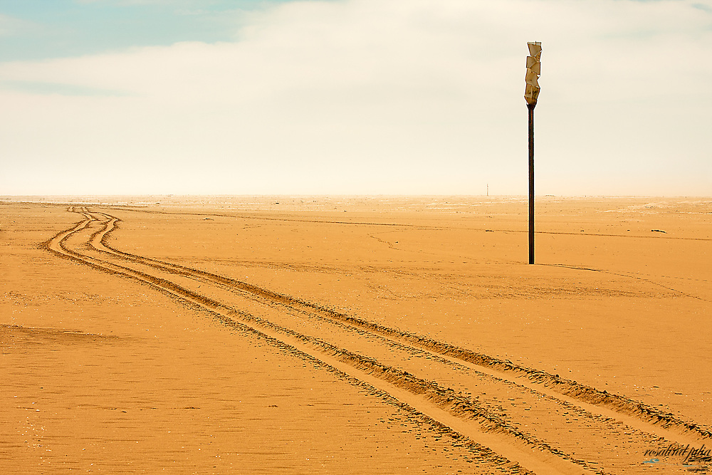 Shipping Signal on a beach with tyre tracks