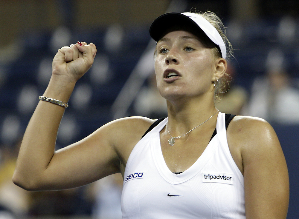 Angelique Kerber of Germany reacts as she plays Serena Williams of the US during their first round match on the first night  of the 2007 US Open tennis tournament in Flushing Meadows, New York 27 August 2007.