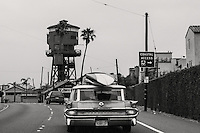 A surfer in a '59 Pontiac Bonneville station wagon about to make a right turn on the Pacific Coast Highway
