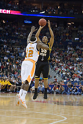 Long Beach State 49ers guard Aaron Nixon (55) shoots over Tennessee Volunteers guard Ramar Smith (12).  The #5 seed Tennessee Volunteers defeated the #12 seed Long Beach State 49ers 121-86  in the first round of the Men's NCAA Tournament in Columbus, OH on March 16, 2007.