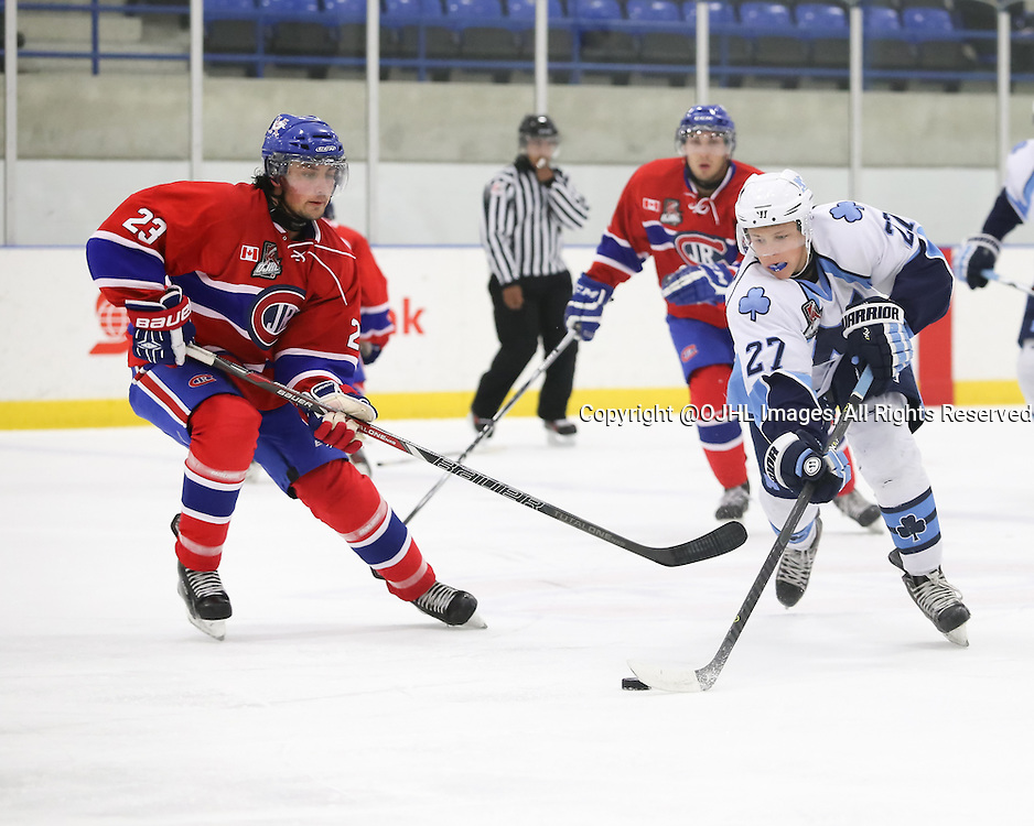 TORONTO, ON - Oct 4, 2015 : Ontario Junior Hockey League game action between St. Michael's and Toronto.<br /> Cameron Wright #27 of the St.Michael's Buzzers, keeps the puck from Sal Filice #23 of the Toronto Jr Canadiens. <br /> (Photo by Anna Matthews / OJHL Images)