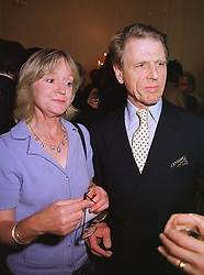MR & MRS EDWARD FOX, he is the actor,  at a party in London on 17th June 1999.<br /> MTK 44