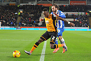 Hull City midfielder Moses Odubajo (2),Brighton defender, full back, Inigo Calderon (14)   during the Sky Bet Championship match between Hull City and Brighton and Hove Albion at the KC Stadium, Kingston upon Hull, England on 16 February 2016. Photo by Ian Lyall.