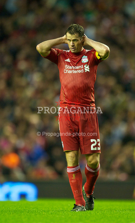 LIVERPOOL, ENGLAND - Thursday, August 19, 2010: Liverpool's Jamie Carragher in action against Trabzonspor during the UEFA Europa League Play-Off 1st Leg match at Anfield. (Pic by: David Rawcliffe/Propaganda)