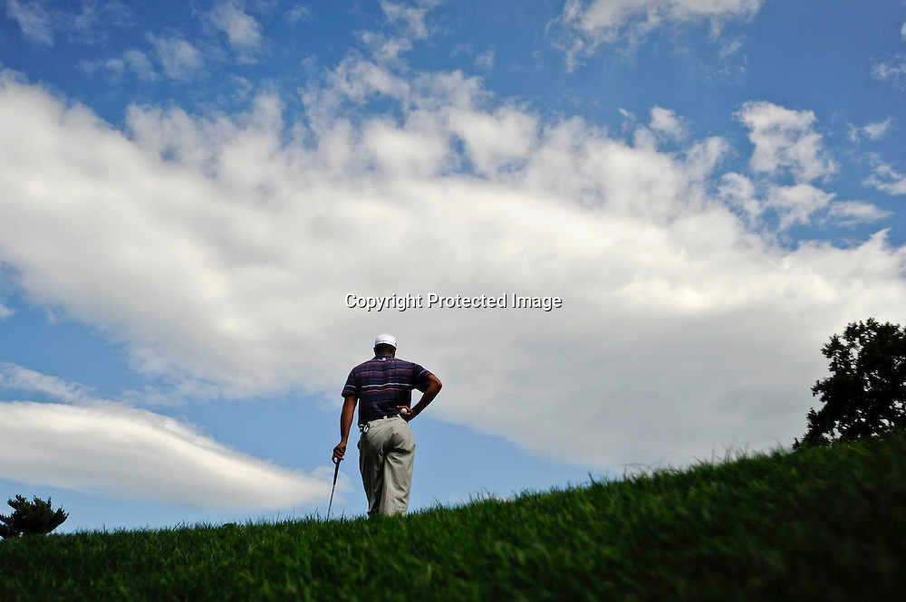 Tiger Woods waits to putt on the 16th green during the second round of the AT&T National PGA golf tournament at Congressional Country Club in Bethesda, Maryland.