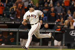 May 24, 2011; San Francisco, CA, USA;  San Francisco Giants catcher Buster Posey (28) scores a run after tagging up at third base against the Florida Marlins during the ninth inning at AT&T Park. Florida defeated San Francisco 5-1.