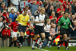 MANCHESTER, ENGLAND - Saturday, April 5, 2003: Liverpool's captain Sami Hyypia leads his side out to face Manchester United during the Premiership match at Old Trafford. (Pic by David Rawcliffe/Propaganda)