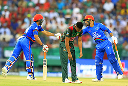 September 20, 2018 - Abu Dhabi, United Arab Emirates - Bangladesh cricketer Abu Hider reacts as Afghanistan cricketers Rashid Khan and Gulbadin  Naib congratulate each other during the 6th cricket match of Asia Cup 2018 between Bangladesh and Afghanistan at the Sheikh Zayed Stadium,Abu Dhabi, United Arab Emirates on September 20, 2018. (Credit Image: © Tharaka Basnayaka/NurPhoto/ZUMA Press)
