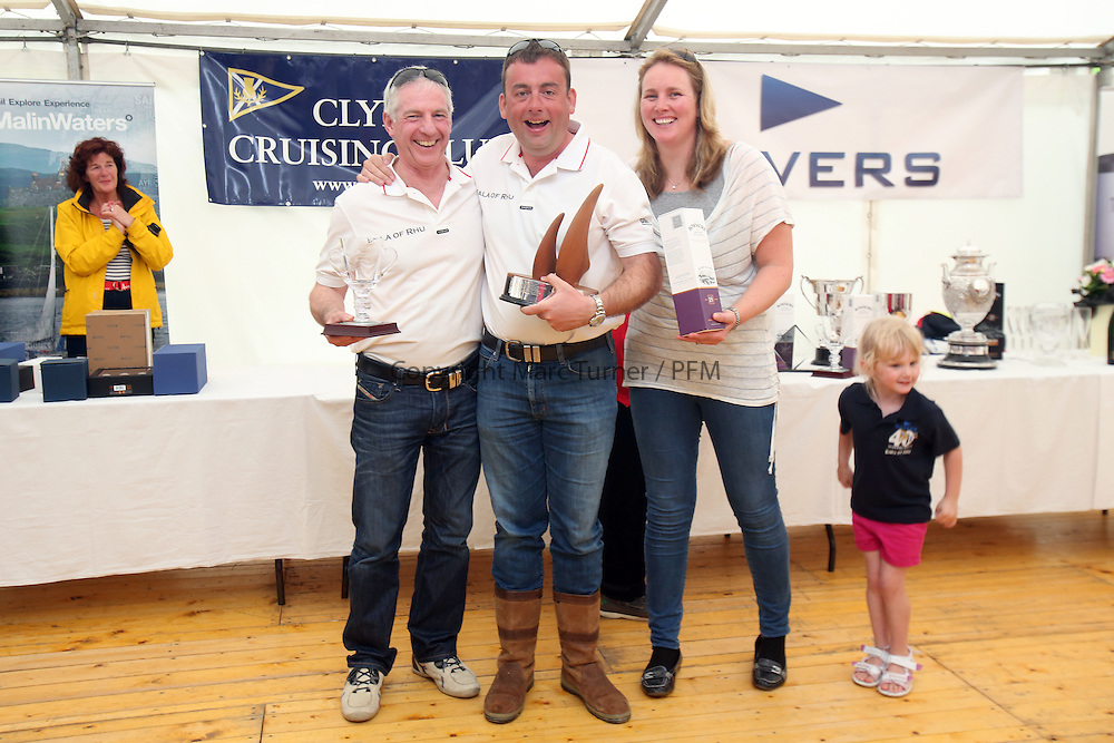 The Silvers Marine Scottish Series 2014, organised by the  Clyde Cruising Club,  celebrates it's 40th anniversary.<br /> <br /> Colin Moore and Jamie McGarry get there class prize from Lesley McGarry and his daughter.<br /> Credit : Marc Turner / PFM