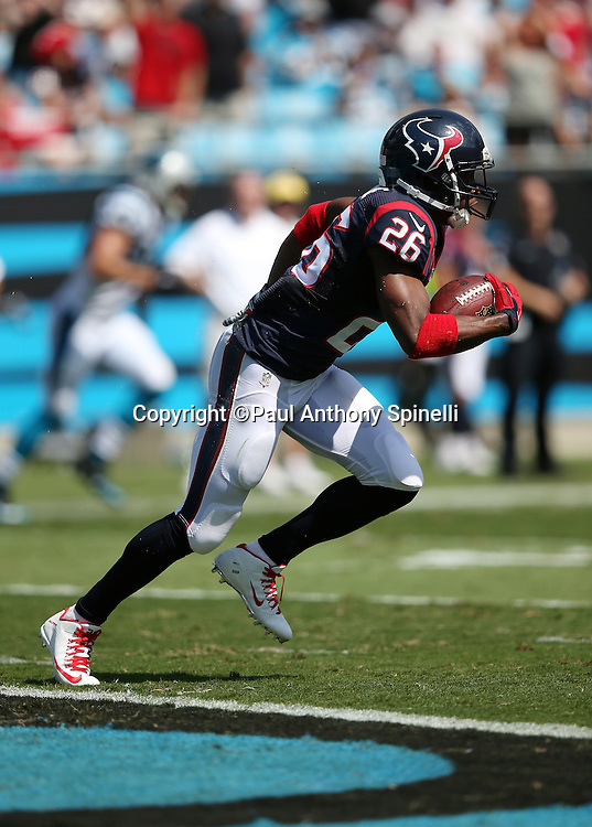 Houston Texans free safety Rahim Moore (26) runs with the ball after intercepting a second quarter pass in the end zone during the 2015 NFL week 2 regular season football game against the Carolina Panthers on Sunday, Sept. 20, 2015 in Charlotte, N.C. The Panthers won the game 24-17. (©Paul Anthony Spinelli)