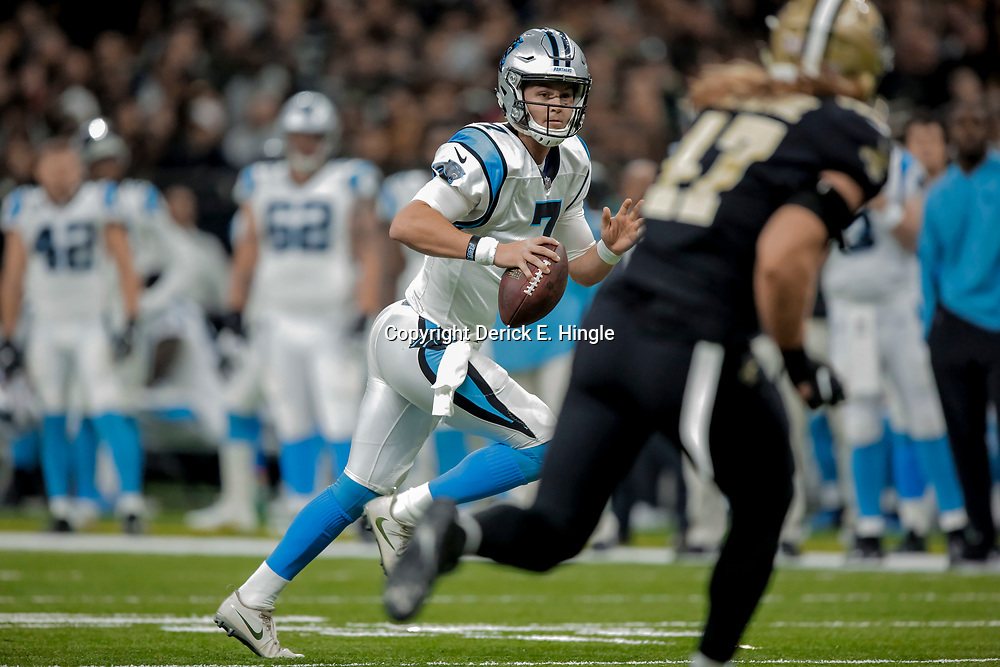 Dec 30, 2018; New Orleans, LA, USA; Carolina Panthers quarterback Kyle Allen (7) runs from New Orleans Saints linebacker Alex Anzalone (47) during the second quarter at the Mercedes-Benz Superdome. Mandatory Credit: Derick E. Hingle-USA TODAY Sports