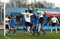 Photo: Paul Greenwood.<br />Macclesfield Town v Hereford United. Coca Cola League 2. 20/01/2007. Macclesfield goalkeeper Tommy Lee, centre, saves under pressure from Hereford's Phil Gulliver (23)