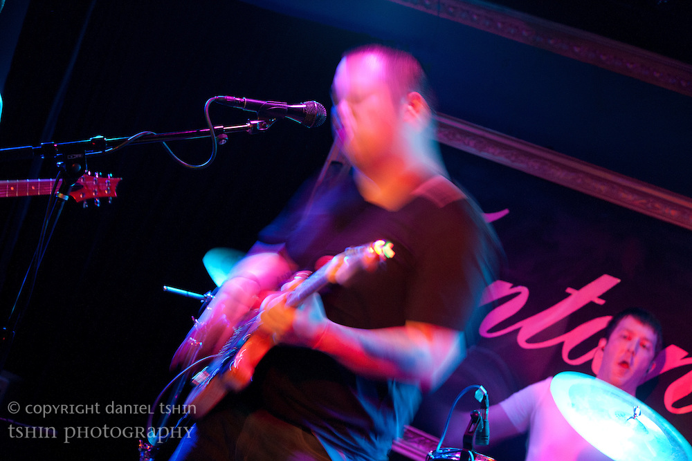 Jon Ho, vocalist, keyboardist and guitarist of Deacons Hail playing at their CD release show at Fontana's Bar