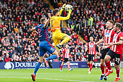 Lincoln City goalkeeper Josh Vickers (1) claims the ball ahead of Sunderland forward Charlie Wyke (9) during the EFL Sky Bet League 1 match between Lincoln City and Sunderland at Sincil Bank, Lincoln, United Kingdom on 5 October 2019.