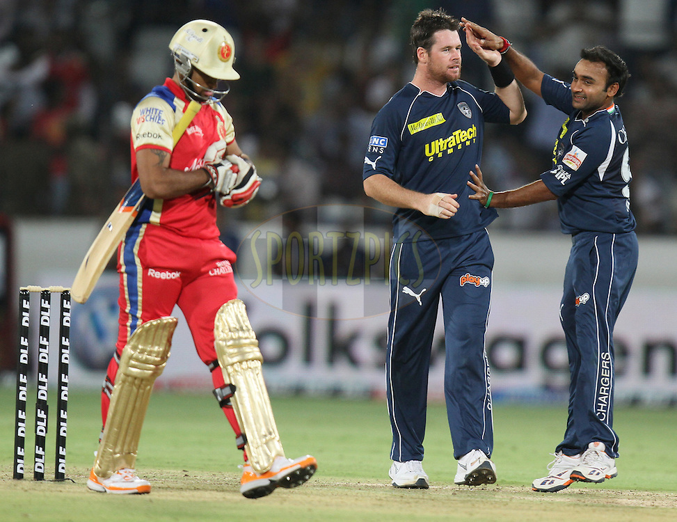 Daniel Chritian (C) and Amit Mishra(R) of DC celebrates after the wicket of Ryan Ninan of RCB during match 11 of the Indian Premier League ( IPL ) between the Deccan Chargers and the Royal Challengers Bangalore held at the Rajiv Gandhi International Cricket Stadium in Hyderabad on the 14th April 2011...Photo by Parth Sanyal/BCCI/SPORTZPICS