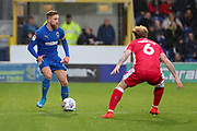 AFC Wimbledon midfielder Scott Wagstaff (7) taking on Gillingham defender Connor Ogilviei (6) during the EFL Sky Bet League 1 match between AFC Wimbledon and Gillingham at the Cherry Red Records Stadium, Kingston, England on 23 November 2019.