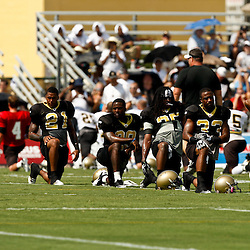 August 1, 2010; Metairie, LA, USA; New Orleans Saints players Darren Sharper (42), Jabari Greer (33), Reggie Jones (35), Danny Gorrer (29), Chip Vaughn (21), and Malcolm Jenkins (27) stretch during a training camp practice at the New Orleans Saints practice facility. Mandatory Credit: Derick E. Hingle