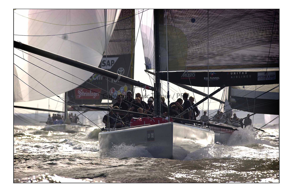 Americas Cup Jubilee,  All of the entrants of ther Jubilee raced round the Isle of Wight as they did for the first race of Cup. The new Team GBR leads last years America's Cup finalists to the finish at Cowes, in their IACC class yachts...Marc Turner / PFM ..