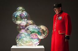 "© Licensed to London News Pictures. 29/06/2017. London, UK.  Chelsea Pensioner Arthur Currie, a former member of The Queen's Royal Irish Hussars, views ""Bubble Cabinet"", 2017, by Jeroen Verhoeven. Members of the public visit Masterpiece London, a leading art fair held in the grounds of the Royal Hospital Chelsea.  The fair brings together 150 international exhibitors presenting works from antiquity to the present day and runs 29 June to 5 July 2017.  Photo credit : Stephen Chung/LNP"
