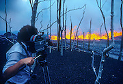Vulcanologist Maurice Krafft filming lava fountaining during the July 1986 eruption at the East Rift Zone of Kilauea in Hawaii Volcanoes National Park.