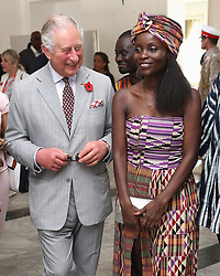The Prince of Wales with Nana Oforiatta Ayim, Member of the Ghana Museums and Monuments Board during a visit to Osu Castle, also known as Fort Christiansborg in Accra, Ghana, on day four of his trip to west Africa with the Duchess of Cornwall.