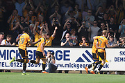 Jevani Brown celebrates scoring from the penalty spot during the EFL Sky Bet League 2 match between Cambridge United and Cheltenham Town at the Cambs Glass Stadium, Cambridge, England on 21 April 2018. Picture by Antony Thompson.