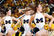ANN ARBOR, MI - FEBRUARY 5: Michigan Wolverines cheerleaders twist and shout as they perform during a timeout in the game against the Ohio State Buckeyes at Crisler Center in Ann Arbor, Michigan on February 5. Michigan won 76-74. (Photo by Joe Robbins)