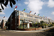 View of one of the buildings in the BedZED housing complex on Thursday, Sep. 6, 2007, in London, UK. BedZED or the Beddington Zero Energy Development, is an environmentally-friendly housing development near Wallington, England in the London Borough of Sutton. It was designed by the architect Bill Dunster who was looking for a more sustainable way of building housing in urban areas in partnership between the BioRegional Development Group and the Peabody Trust. There are 82 houses, 17 apartments and 1,405 square meters of work space were built between 2000. The project was shortlisted for the Stirling Prize in 2003. The project is designed to use only energy from renewable source generated on site. In addition to 777 square meters of solar panels, tree waste is used for heating and electricity. The houses face south to take advantage of solar gain, are triple glazed and have high thermal insulation while most rain water is collected and reused. Appliances are chosen to be water efficient and use recycled water wherever possible. Low impact building materials were selected from renewable or recycled sources and were all originating within a 35 mile radius of the site to minimize the energy required for transportation. Also, refuse collection facilities are designed to support recycling and the site encourage eco-friendly transport: electric and LPG cars have priority over petrol/diesel cars, and electricity is provided by parking spaces appositely built for charging electric cars.