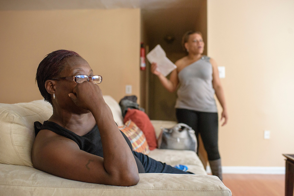 Baltimore, Maryland - April 30, 2015: Penn North Community Resource Center resident roommates Monica Morton, left, and Marquita Carroll, right, hangout in the 12 person supportive housing apartment's living room Thursday April 30, 2015. The residents either come straight from prison, were homeless or referred by an inpatient facility. <br /> <br /> The poor, predominately black area of Baltimore known as Sandtown is where the most violent riots occurred the week Freddie Gray was laid to rest. Tensions between the are's residents and police have been bubbling long before Freddie Gray died while in police custody. <br /> <br /> CREDIT: Matt Roth for The Globe and Mail