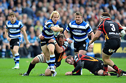 Bath fullback Nick Abendanon is tackled in possession - Photo mandatory by-line: Patrick Khachfe/JMP - Tel: Mobile: 07966 386802 19/10/2013 - SPORT - RUGBY UNION - Recreation Ground - Bath - Bath V Newport Gwent Dragons - Amlin Challenge Cup