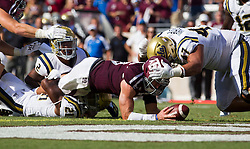 Texas A&M quarterback Trevor Knight (8) dives over the goal line for a touchdown as UCLA defensive back Tahaan Goodman (21) attempts to tackle him during the third quarter of an NCAA college football game Saturday, Sept. 3, 2016, in College Station, Texas. Texas A&M won 31-24 in overtime. (AP Photo/Sam Craft)