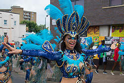 London, August 29th 2016. The procession makes its way along Ladbroke Grove during day two of Europe's biggest street party, the Notting Hill Carnival.
