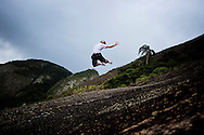 """BRAZIL Rio de Janeiro (RJ) 10/12/2010 - At Itacoatiara beach, in Niteroi, state of Rio de Janeiro the surfers have created a new kind of sport, called """"surfing in stone"""".  The radical sport is to run in a giant stone and practice jumps, maneuvers, and tricks."""