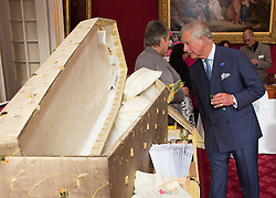 LONDON - UK - 10- SEPT - 2013: Britain's Prince Charles, The Prince of Wales, President, The Prince&rsquo;s Initiative for Mature Enterprise (PRIME), hosts a reception to celebrate PRIME entrepreneurs over the age of 50, supporters and volunteers, St James&rsquo;s Palace State Apartments, London. HRH also viewed some of the products produced by PRIME businesses.<br /> The Prince looks at a coffin..<br /> Photo by Ian Jones