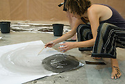 Artist at work in her studio. Model released