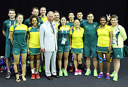 Image licensed to i-Images Picture Agency. 23/07/2014. Glasgow, United Kingdom. The Prince of Wales poses for a photo with the Australian badminton players during a visit to the Commonwealth Games in Glasgow  Picture by Stephen Lock / i-Images