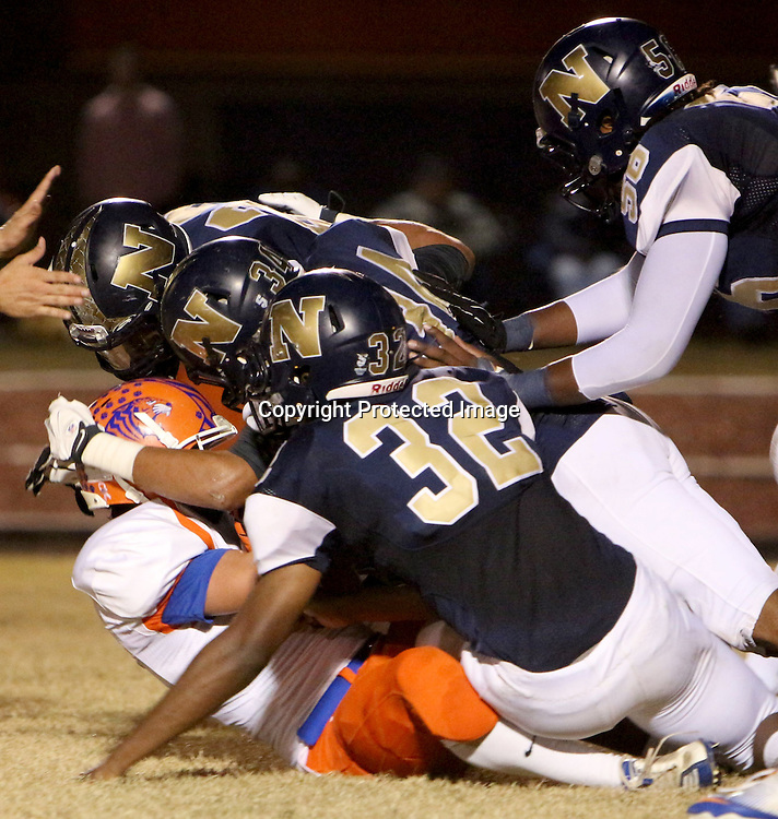 Randleman's Bradley Berridge is tackled by North Brunswick's DeShawn Montgomery, back-left, Dominique Blanks, Evin Bellamy, and Jabril Robinson, top-left. (Jason A. Frizzelle)