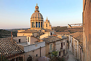 Duomo San Giorgio, designed by Rosario Gagliardi and built 1738-75 in Sicilian Baroque and Neoclassical style, in Ragusa Ibla, in Sicily, Italy. The town of Ragusa is split into the lower and older town of Ragusa Ibla, and the higher upper town of Ragusa Superiore, separated by the Valle dei Ponti. It is built on the site of an ancient city, inhabited by Sicels, Greeks, Carthaginians, Romans, Byzantines, Arabs and Normans. In 1693 it was devastated by an earthquake, and was rebuilt in the Baroque style. The town forms part of the Late Baroque Towns of the Val di Noto UNESCO World Heritage Site. Picture by Manuel Cohen